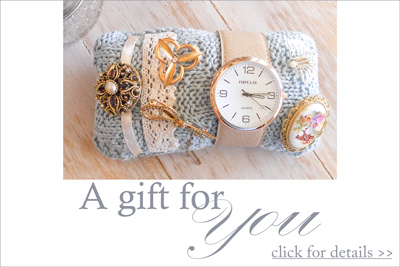 a gift for you - receive this brooch pillow knitting pattern free when you order any item from our store until the end of May.  Click here for details