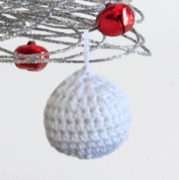 closeup of our crocheted christmas bauble free knitting pattern