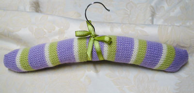 Image of our finished Striped Coat Hanger Cover knitting pattern