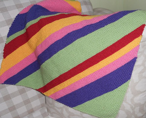 Image of our finished womblankie, knitted diagonally in stripes