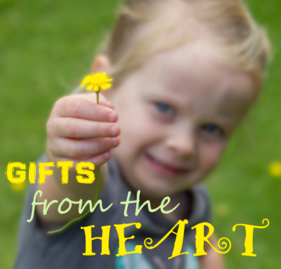 Gifts from the Heart - toddler holding out a dandelion