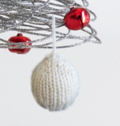 Closeup of our knitted Christmas Tree Bauble, free pattern